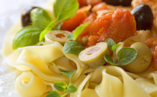 fresh pasta with olives and basil